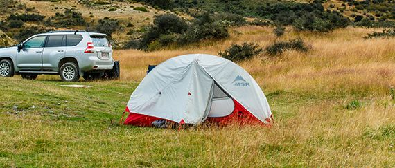 Camping with a backpacking tent on a grassland